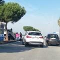 Incidente in via Olivetti: scontro fra due auto, una si capovolge